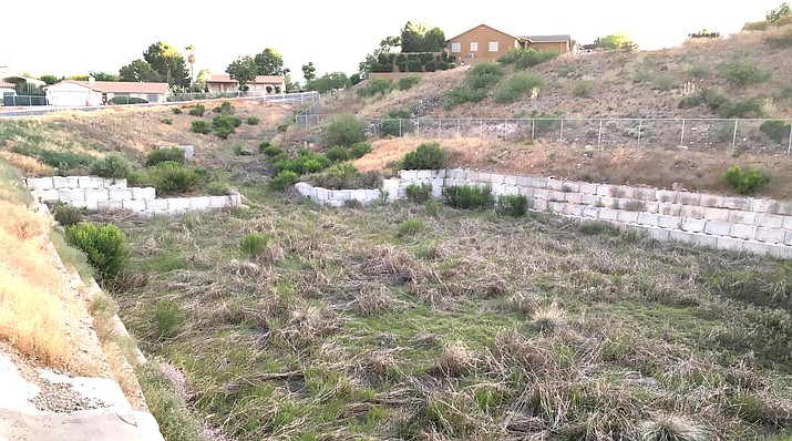 Camp Verde's Public Works department has plans in the next week or so to clean up the water catchment basin on Cliffs Parkway, Public Works Director Ron Long said. VVN/Bill Helm