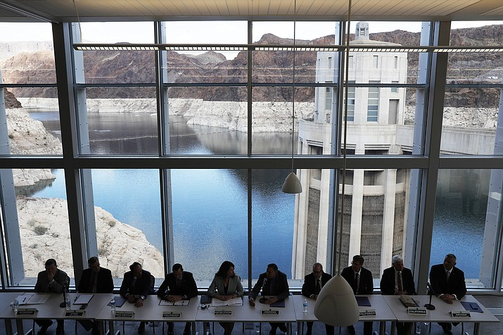 Representatives from seven states and the federal government sit during a news conference at Hoover Dam before a ceremony for a Colorado River drought contingency plan, Monday, May 20 in Boulder City, Nevada. (AP Photo/John Locher)