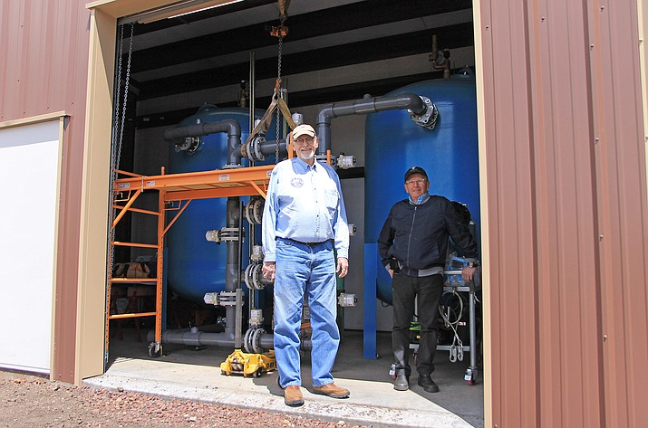 City councilmembers Jim Wurgler and Bernie Hiemenz inspect the new arsenic treatment plant at the Rodeo Well in Williams.
