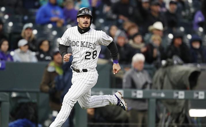 Colorado Rockies' Nolan Arenado scores a double hit by Daniel Murphy off Arizona Diamondbacks starting pitcher Merrill Kelly in the fourth inning of a game, Tuesday, May 28, 2019, in Denver. (David Zalubowski/AP)