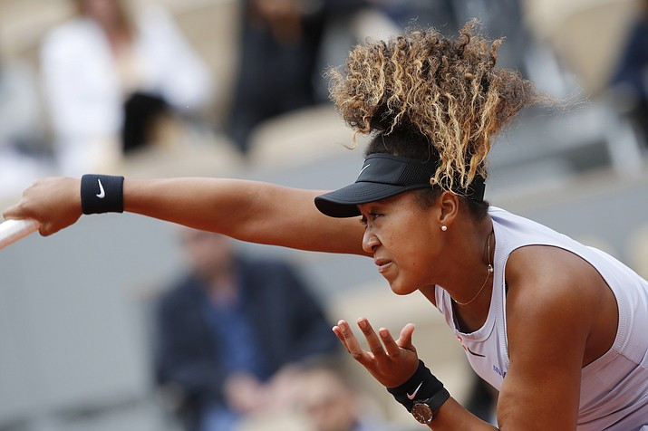 Japan's Naomi Osaka serves against Slovakia's Anna Karolina Schmiedlova during their first round match of the French Open at Roland Garros stadium in Paris, Tuesday, May 28, 2019. (Christophe Ena/AP)