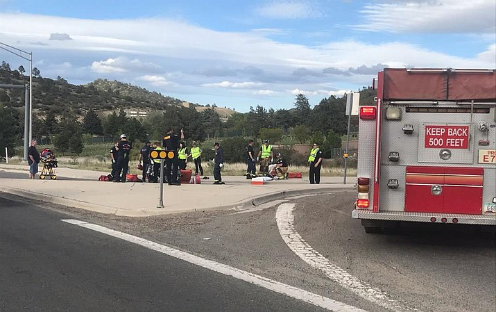 Members of the Prescott Fire Department help two people involved in a motorcycle accident near Overland Trail and Gurley Street on Sunday, May 26, 2019. 58-year-olds Jesse Gerhardt Jr. and Tamara Kelley were listed as critical at a Phoenix-area hospital, according to the Prescott Police Department on Tuesday, May 28, 2019. (Prescott Fire/Courtesy)