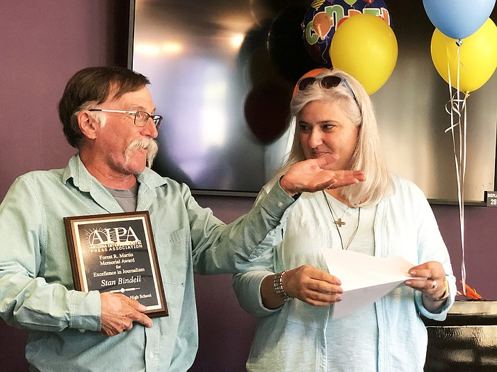 Hopi High media teacher Stan Bindell receives top journalism award from AIPA past president Christine Brandell-Melendez. (Photo/Anna Horton)