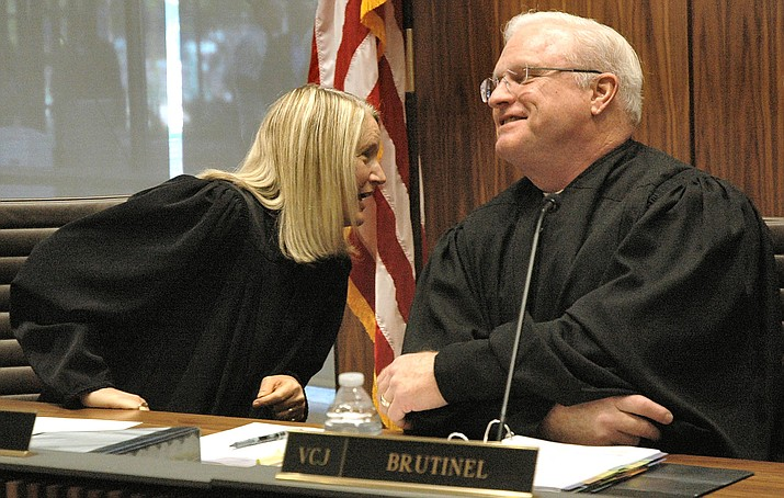Justice Ann Scott Timmer, left, chats with colleague Robert Brutinel during a break in arguments in March regarding the question of marijuana extracts. (Capitol Media Services photo by Howard Fischer)