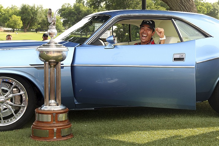 Kevin Na reacts as he revs the engine of a fully restored 1973 Dodge Challenger that he was presented with after winning the Charles Schwab Challenge golf tournament Sunday, May 26, 2019, in Fort Worth, Texas. (AP Photo/ Richard W. Rodriguez)