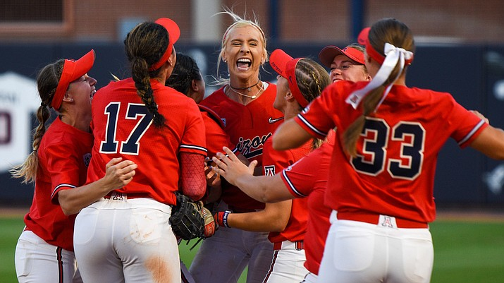 Arizona players celebrate after defeating Ole Miss and advancing to the Women's College World Series. It will be the 23rd time for the program. (Photo by Brady Vernon/Cronkite News)