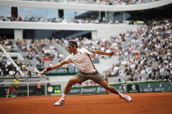 Switzerland's Roger Federer plays a shot against Germany's Oscar Otte during their second round match of the French Open at the Roland Garros stadium in Paris, Wednesday, May 29, 2019. (Christophe Ena/AP)
