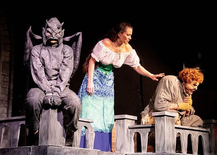 "Leah Morales, middle, and Jeremy Zuhlke, right, perform in ""The Hunchback of Notre Dame"". (Joe Webster/Courtesy)"