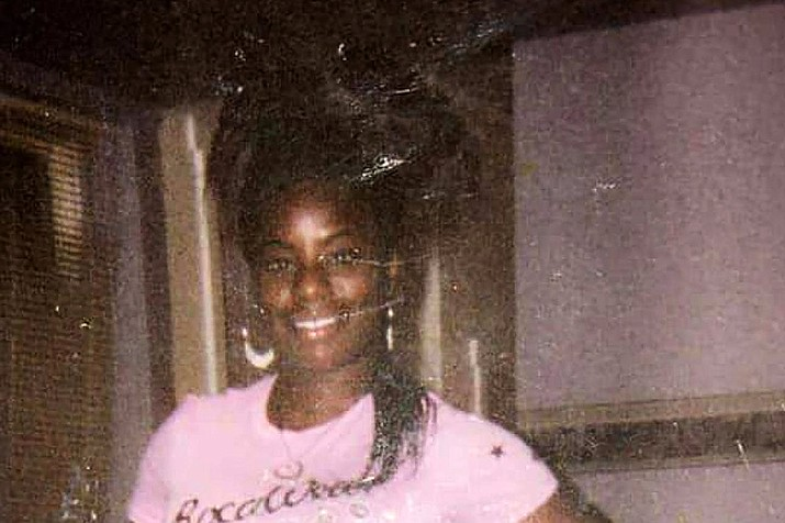 This undated family photo provided by Riccardo Holyfield shows his cousin, Reo Renee Holyfield. Her body was in a dumpster, and nobody found her for two weeks last fall. The slayings like Holyfield's that began in 2001 continued for years and remain unsolved. Now a national nonprofit group and a computer algorithm are helping detectives review the cases and revealing potential connections. The renewed investigation offers hope to the victims' relatives, some of whom have waited nearly two decades for answers. (Courtesy of Riccardo Holyfield)