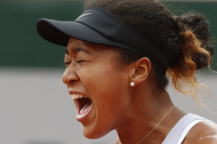 Japan's Naomi Osaka screams after scoring a point against Victoria Azarenka of Belarus during their second round match of the French Open tennis tournament at the Roland Garros stadium in Paris, Thursday, May 30, 2019. (Jean-Francois Badias/AP)