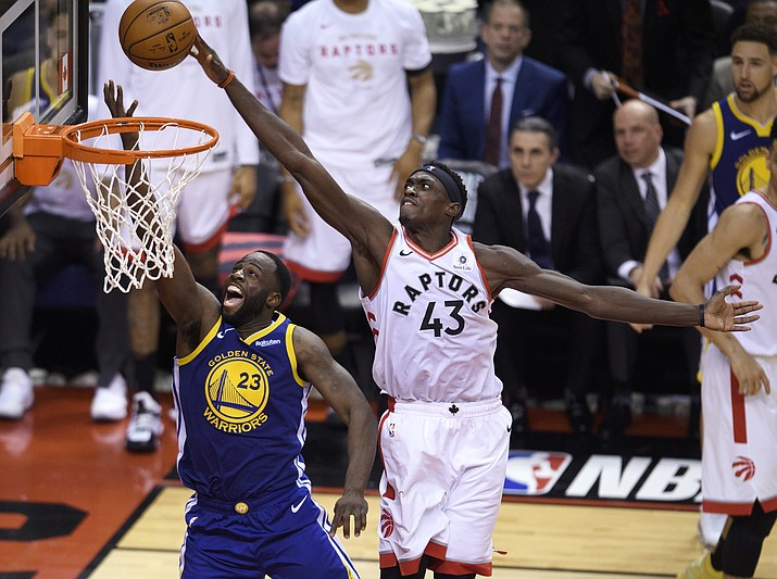 Toronto Raptors forward Pascal Siakam (43) blocks a shot by Golden State Warriors forward Draymond Green (23) during the second half of Game 1 of the NBA Finals, Thursday, May 30, 2019, in Toronto. (Nathan Denette/The Canadian Press via AP)