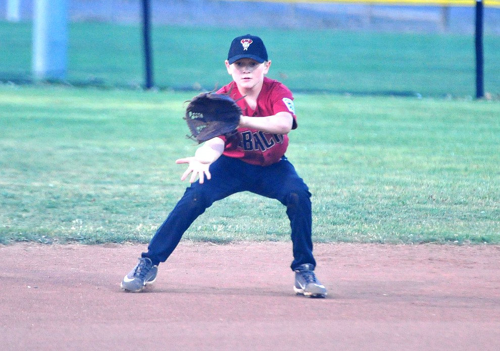 Verde Valley's Ezra Kubrock makes the play at shortstop against Bagdad at the Little League Tournament of Champions in Chino Valley Saturday May 31.  (Les Stukenberg/Courier)