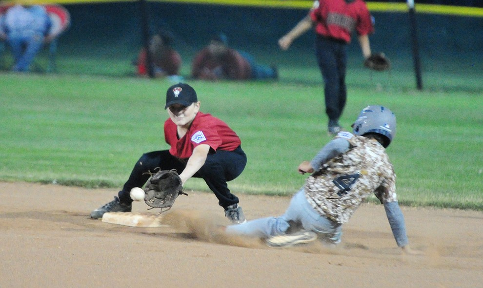 Bagdad's Joey Kirchoff slides in safely to second as Verde Valley's Ezra Kubrock waits on the ball at the Little League Tournament of Champions in Chino Valley Saturday May 31.  (Les Stukenberg/Courier)
