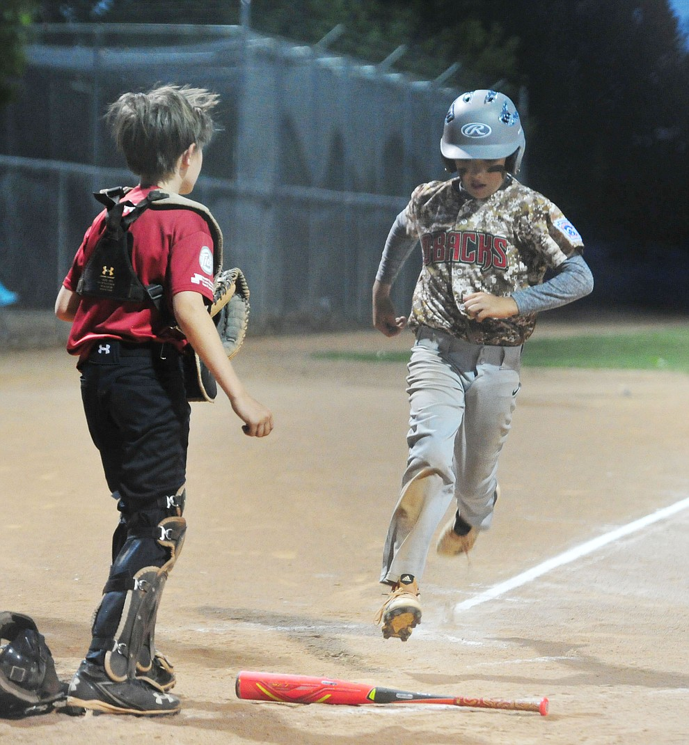 Bagdad's Joey Kirchoff scores against Verde Valley at the Little League Tournament of Champions in Chino Valley Saturday May 31.  (Les Stukenberg/Courier)