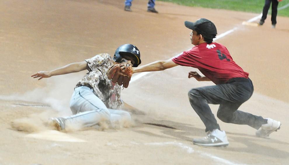 Bagdad's Ezra Aguilar slides safely home under the tag of Verde Valley's Xzayvier Buckner at the Little League Tournament of Champions in Chino Valley Saturday May 31.  (Les Stukenberg/Courier)