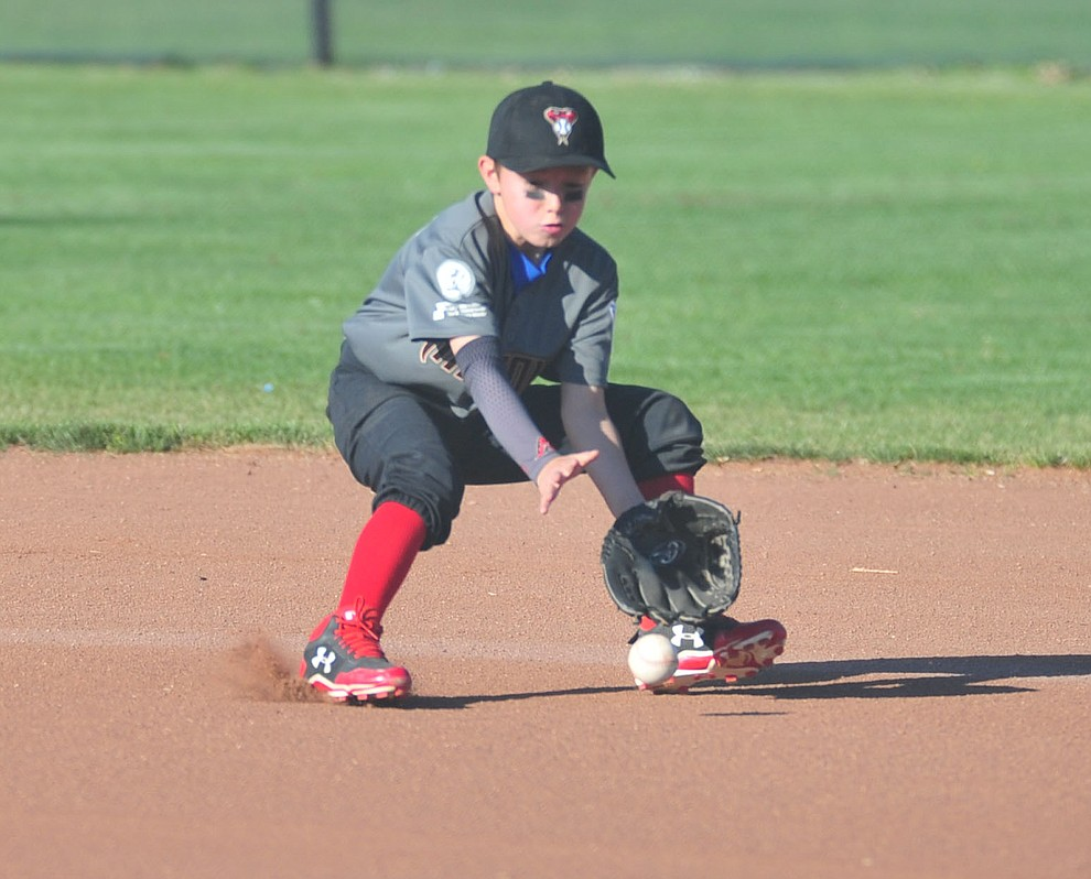 Prescott Valley's Trevor Field fields the ball at second base against Prescott at the Little League Tournament of Champions in Chino Valley Saturday May 31.  (Les Stukenberg/Courier)