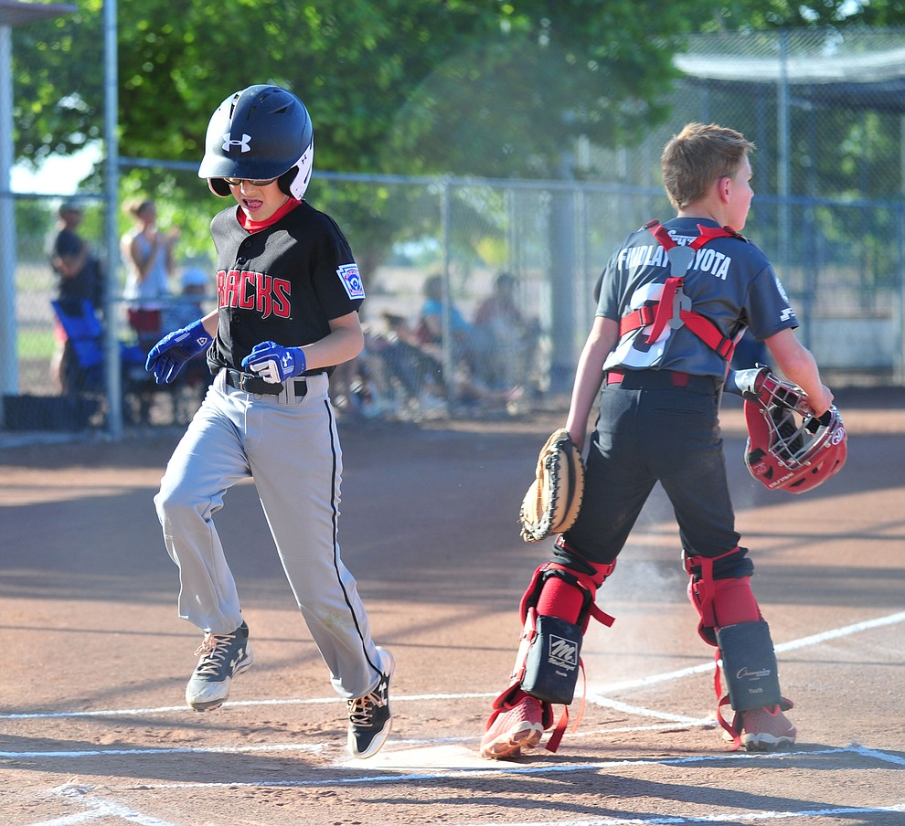 Prescott's Caden Bernier scores at the Little League Tournament of Champions in Chino Valley Saturday May 31.  (Les Stukenberg/Courier)