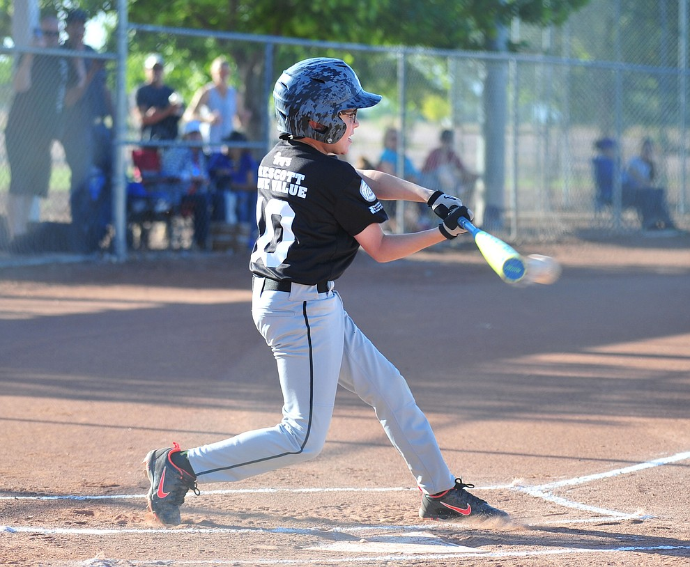 Prescott's Mike Falick makes contact against Prescott Valley at the Little League Tournament of Champions in Chino Valley Saturday May 31.  (Les Stukenberg/Courier)