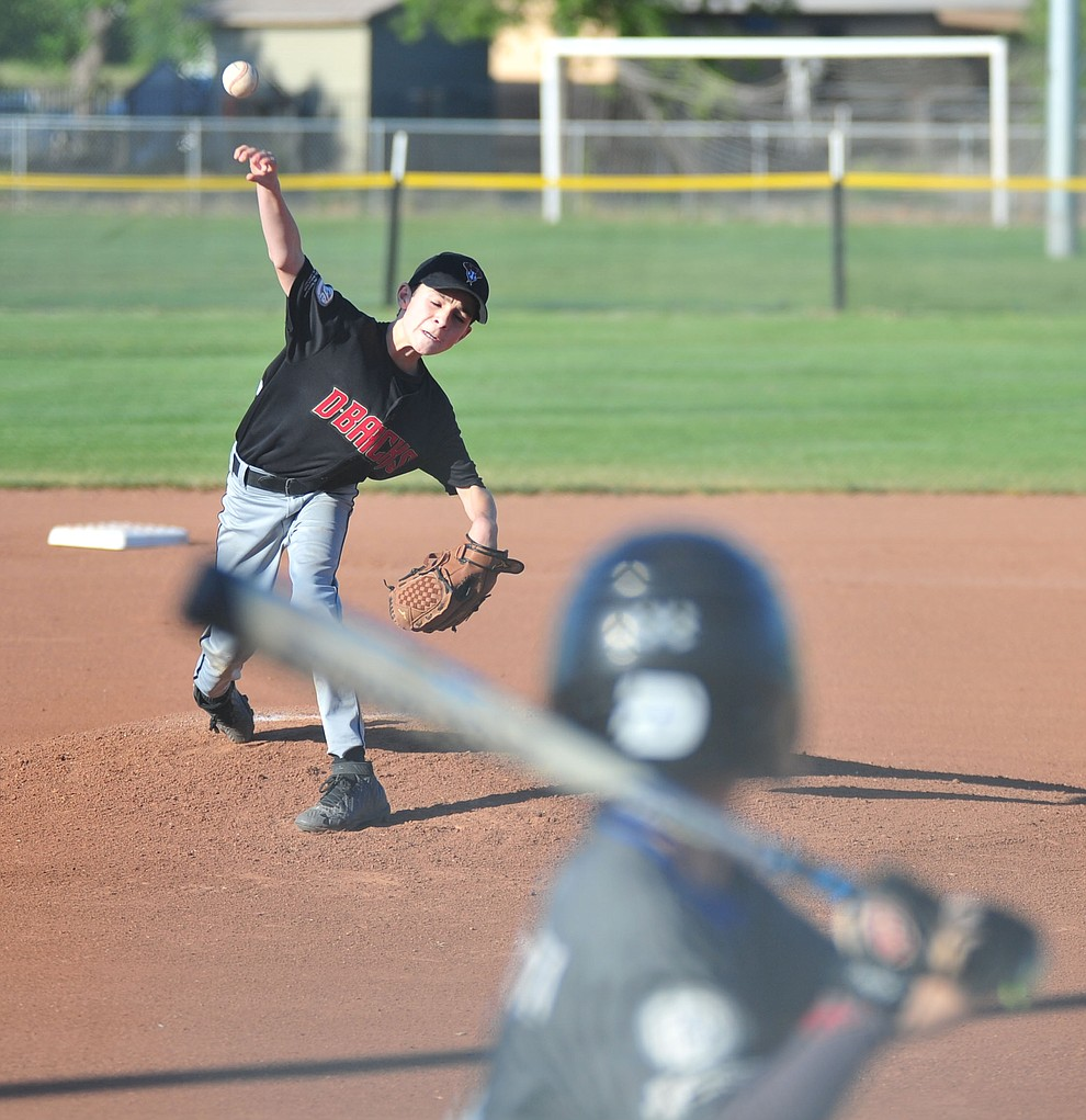 Prescott's Jake Diener delivers a pitch at the Little League Tournament of Champions in Chino Valley Saturday May 31.  (Les Stukenberg/Courier)