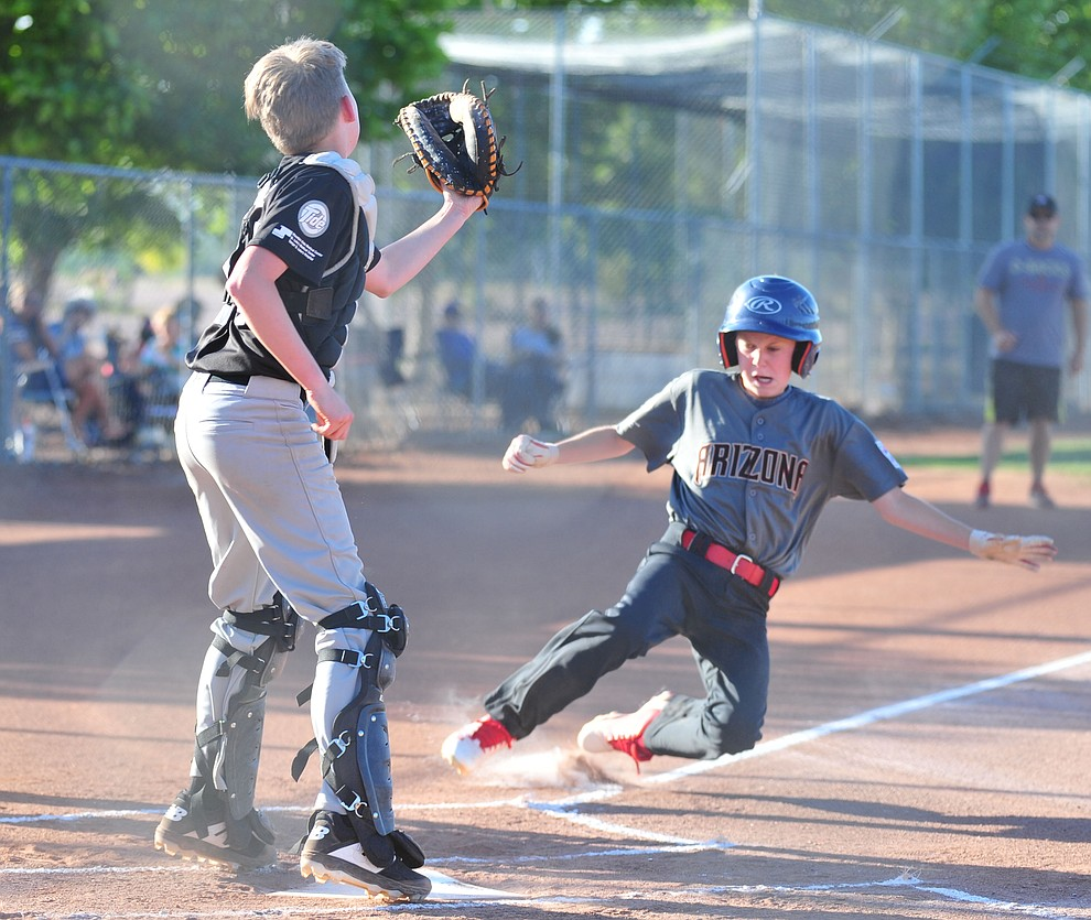 Prescott Valley's Connor Wallace scores against Prescott at the Little League Tournament of Champions in Chino Valley Saturday May 31.  (Les Stukenberg/Courier)