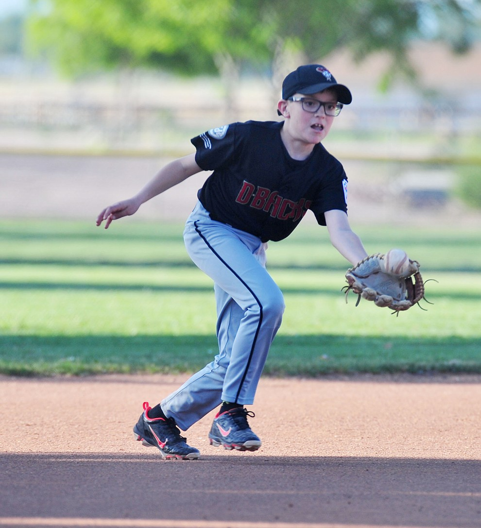 Prescott's Mike Falick fields the ball at third against Prescott Valley at the Little League Tournament of Champions in Chino Valley Saturday May 31.  (Les Stukenberg/Courier)