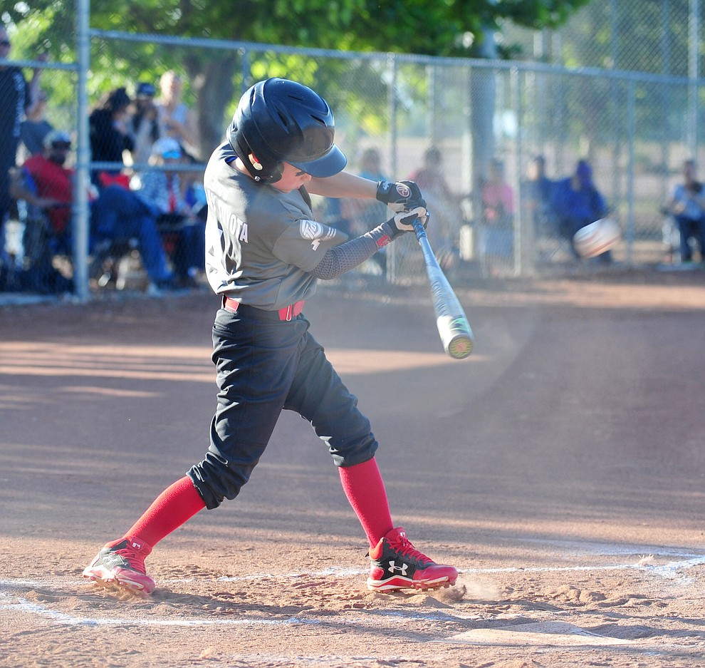 Prescott Valley's Trevor Field hits a triple against Prescott at the Little League Tournament of Champions in Chino Valley Saturday May 31.  (Les Stukenberg/Courier)