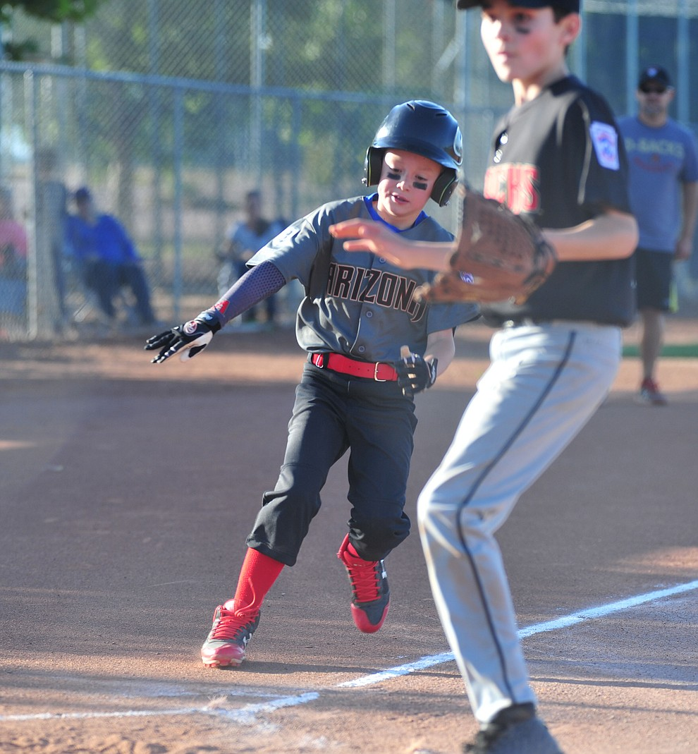Prescott Valley's Trevor Field scores against Prescott at the Little League Tournament of Champions in Chino Valley Saturday May 31.  (Les Stukenberg/Courier)