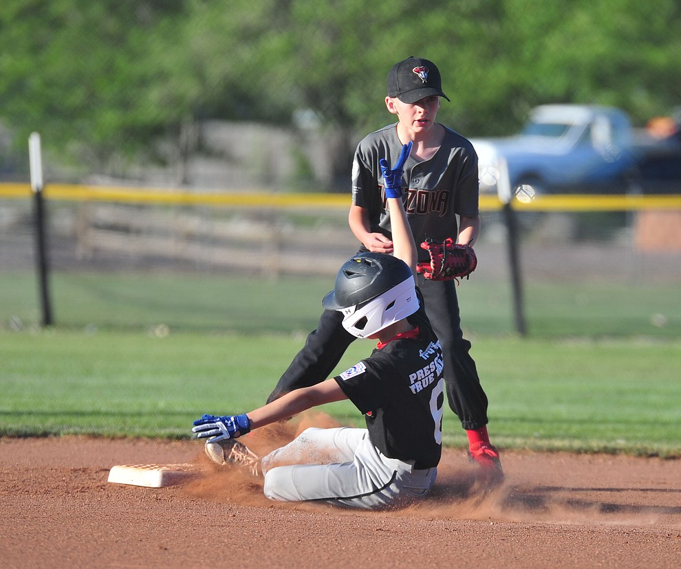 Prescott Valley's Colter Smith gets the force on a Prescott's Caden Bernier at the Little League Tournament of Champions in Chino Valley Saturday May 31.  (Les Stukenberg/Courier)