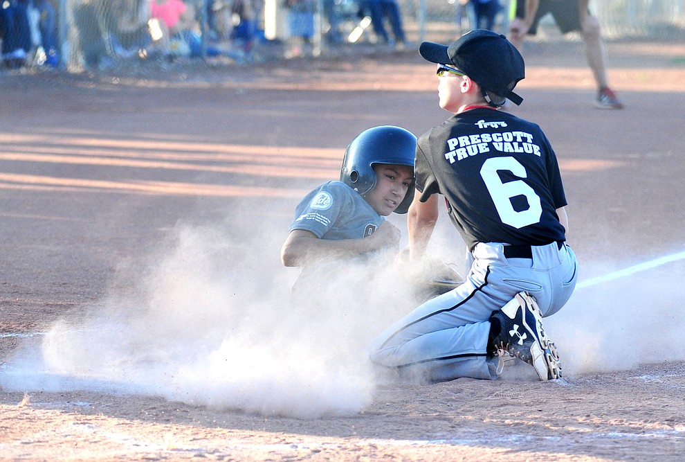 Prescott's Caden Bernier tags out Prescott Valley's Antonio Valenzuela at home at the Little League Tournament of Champions in Chino Valley Saturday May 31.  (Les Stukenberg/Courier)