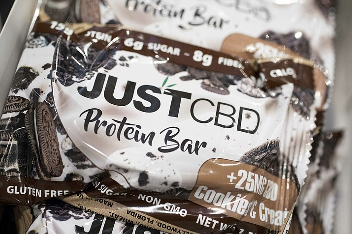 A cookies and cream flavored protein bar marketed by JustCBD is displayed at the Cannabis World Congress & Business Exposition trade show, Thursday, May 30, 2019 in New York. (Mark Lennihan/AP)