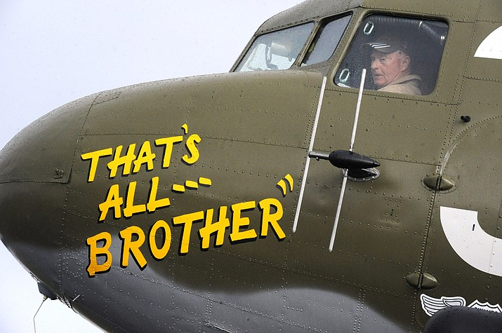 Pilot Tom Travis sits in the cockpit of the World War II troop carrier That's All, Brother during a stop April 9, 2019, in Birmingham, Ala. The C-47 aircraft, which led the main Allied invasion of Europe on June 6, 1944, is returning to the continent to participate in events marking the 75th anniversary of D-Day in June. (Jay Reeves/AP)