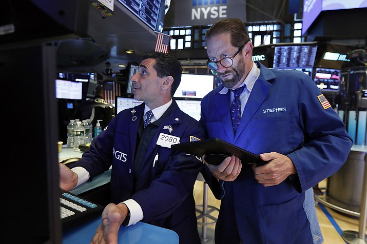 In this May 28, 2019, file photo specialist Peter Mazza, left, and trader Stephen Gilmartin work on the floor of the New York Stock Exchange. (Richard Drew/AP, File)