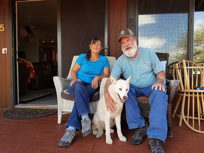 David Dick, Ramona Reynolds and their Husky, Sadie, were attacked by a pit bull in their Prescott neighborhood on Dec. 17, 2018. (Max Efrein/Courier)