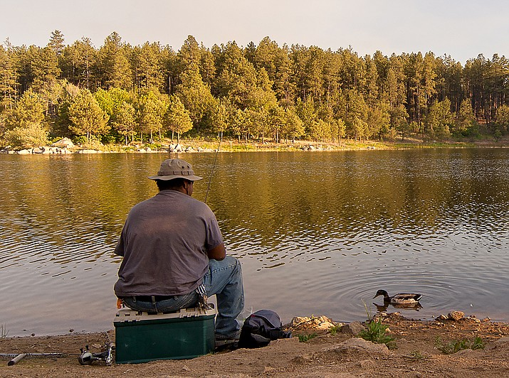 Luis Mendoza waits for a bite while fishing at Goldwater Lake on June 18, 2015, in Prescott. Goldwater Lake will host a Free Fishing Day on Saturday, June 1. (Courier, File)