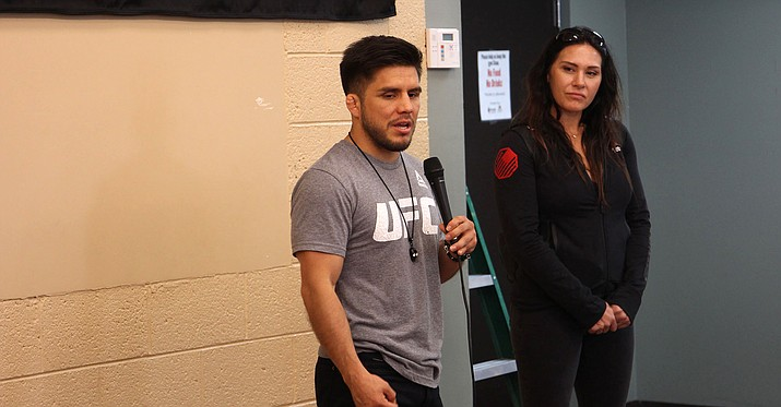 Henry Cejudo points to his roots as helping him become the fighter he is today. He recently returned to the Golden Gate Campus of Wesley Community & Health Centers to speak to kids now growing up in his old neighborhood. (Photo by Evaristo Montoya/Cronkite News)
