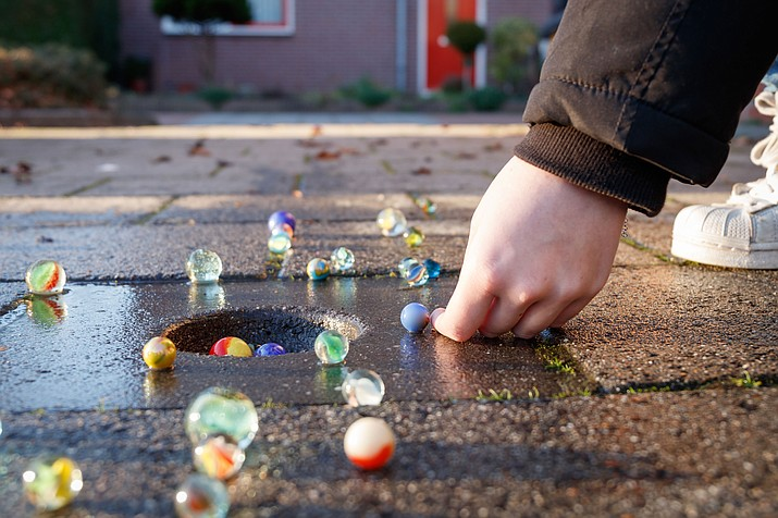 Someone suggested giving teachers marbles to scatter in hallways to slow a gunman. (Adobe Images)