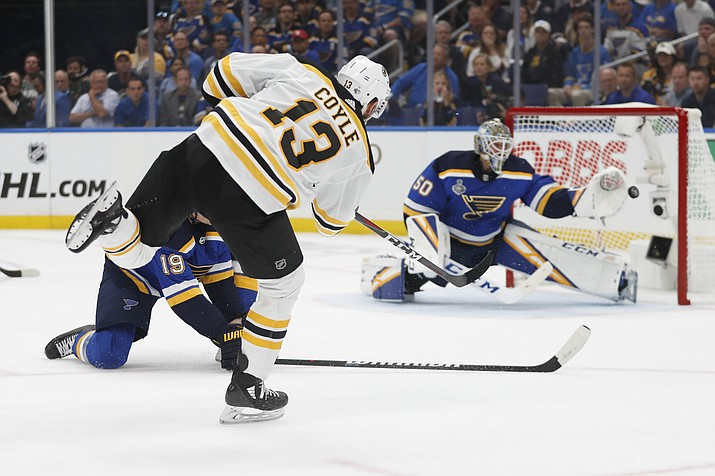 Boston Bruins center Charlie Coyle (13) scores a goal against St. Louis Blues goaltender Jordan Binnington (50) during the first period of Game 3 of the NHL Stanley Cup Final Saturday, June 1, 2019, in St. Louis. (Jeff Roberson/AP)