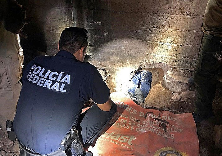 Mexican Federal Police officers examine the Nogales-Sonora, Mexico, entrance to an incomplete cross-border tunnel. (U.S. Customs and Border Protection)