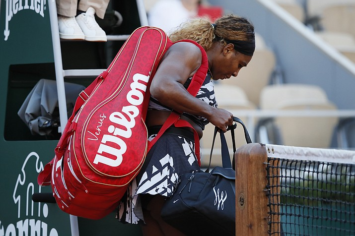 Serena Williams of the U.S. leaves after losing her third-round match of the French Open against Sofia Kenin of the U.S. in two sets, 2-6, 5-7, at the Roland Garros stadium in Paris, Saturday, June 1, 2019. (Christophe Ena/AP)