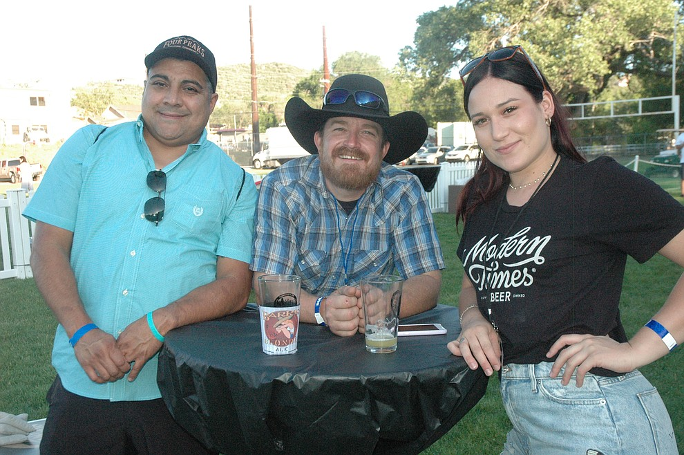 Michael Monroe, Justin Belverud and Stephanie Henderson enjoying their time  at the ninth annual Party in the Pines held at Prescott Mile High Middle School athletic field Saturday, June 1. Proceeds went to supporting the Prescott Unified School District Education Foundation. (Jason Wheeler/Courier)