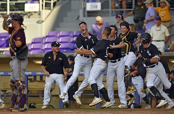 Southern Mississippi celebrates after defeating Arizona State on a two-RBI single in the bottom of the ninth inning in an NCAA tournament regional game Sunday, June 2, 2019, in Baton Rouge, La. (Hilary Scheinuk/The Advocate via AP)