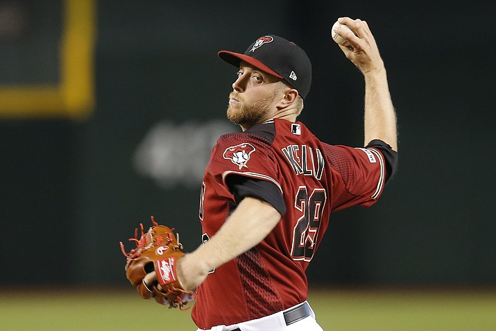Arizona Diamondbacks pitcher Merrill Kelly throws in the first inning during a game against the New York Mets, Sunday, June 2, 2019, in Phoenix. (Rick Scuteri/AP)