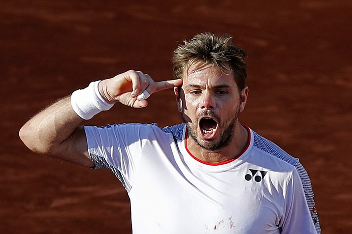 Switzerland's Stan Wawrinka celebrates winning his fourth round match of the French Open against Greece's Stefanos Tsitsipas in five sets, 7-6 (8-6), 5-7, 6-4, 3-6, 8-6, at the Roland Garros stadium in Paris, Sunday, June 2, 2019. (Christophe Ena/AP)