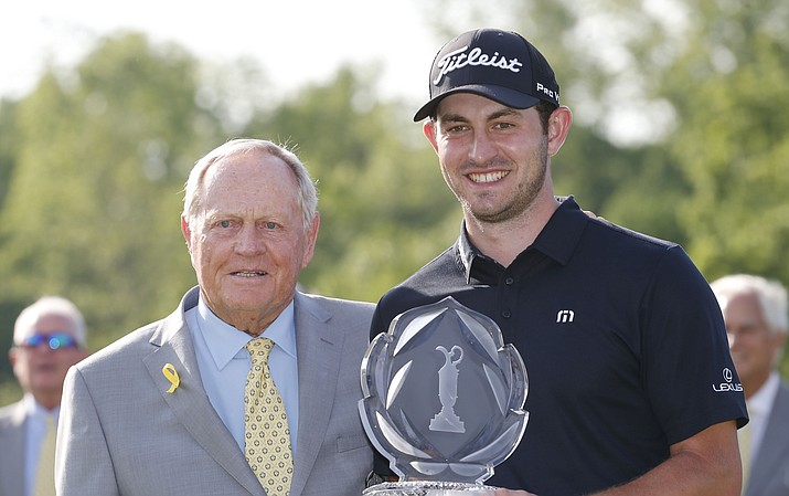Jack Nicklaus, left, presents Patrick Cantlay with the trophy after Cantlay won the Memorial golf tournament Sunday, June 2, 2019, in Dublin, Ohio. (Jay LaPrete/AP)