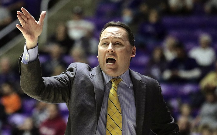 In this Jan. 4, 2018 photo, NAU coach Jack Murphy calls to his team during the first half against Weber State, in Ogden, Utah. Murphy is leaving the Lumberjacks to become the associate head coach at Arizona, his alma mater. (Matt Herp/Standard-Examiner via AP, file)