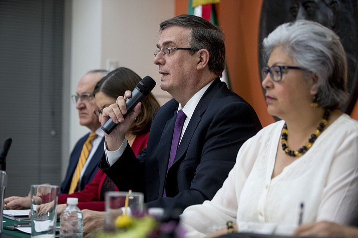 Mexican Foreign Affairs Secretary Marcelo Ebrard, center, speaks at a news conference at the Mexican Embassy in Washington, Monday, June 3, 2019, as a Mexican delegation arrives in Washington for talks following trade tariff threats from the Trump Administration. (Andrew Harnik/AP)
