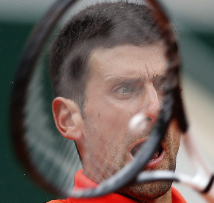 Serbia's Novak Djokovic plays a shot against Germany's Jan-Lennard Struff during their fourth round match of the French Open at the Roland Garros stadium in Paris, Monday, June 3, 2019. (Christophe Ena/AP)