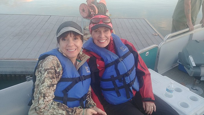 Water safety should be the most important aspect of your summer boating activities. Above, Kara Jensen and Marsha Sue wearing life jackets at Lake Mead. (Photo special to the Miner)