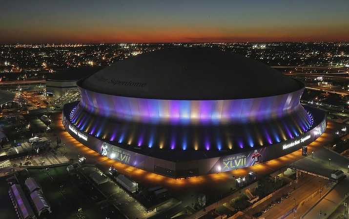 Pictured is the Superdome, where the NFL Super Bowl XLVII football game between the San Francisco 49ers and Baltimore Ravens will be played on Feb. 3, is seen at sunset in New Orleans. The Superdome has outlasted seven other domed stadiums from the AstroTurf era that have come and gone, even surviving Hurricane Katrina that forced the Saints to play elsewhere in 2005. The spaceship-like building, which opened in 1975, has hosted seven Super Bowls. (AP Photo/Charlie Riedel, File)