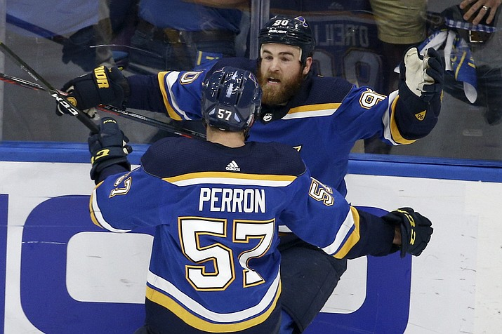 St. Louis center Ryan O'Reilly (90) celebrates with David Perron (57) after O'Reilly scored his second goal of the game during Game 4 of the NHL Stanley Cup Final against Boston Monday, June 3, 2019, in St. Louis. (Scott Kane/AP)